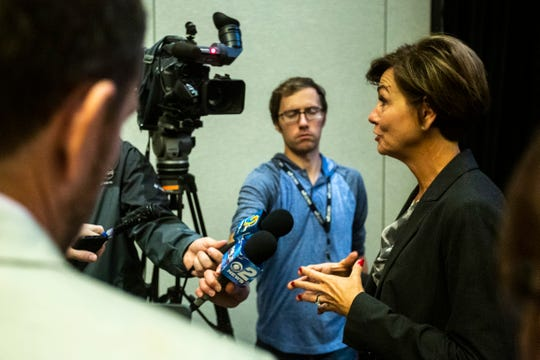 Iowa Gov. Kim Reynolds speaks with reporters after a press conference at ACT's computational psychometrics conference, Thursday, Oct., 10, 2019, at the Coralville Marriott Hotel & Conference Center in Coralville, Iowa.