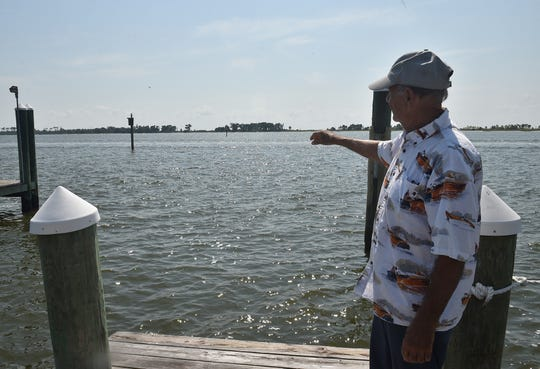Ronald Baker points out where he and other family members once lived on Deer Island.