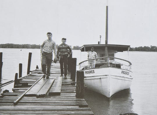 Arthur Baker (right) drops off his sons Alvin (left) and Ronald on a pier as they make their way to school in Biloxi.