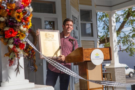 Brent Waugh, Fourth and Gill resident and fundraising head for the porch project, shows the plaque that will be filled in with donors' names, then installed in the foyer of the home. Oct. 4, 2019.