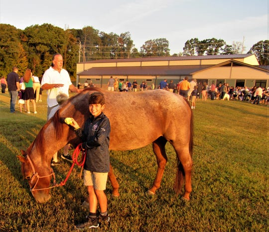 Wylie Nielsen brought his horse Risky for a blessing.  Both are 10 years old and share the same birthday!
