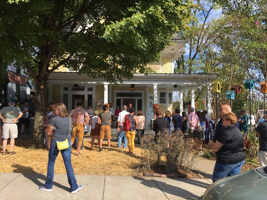 Fourth and Gill neighbors and fans celebrate the new porch. Oct. 4, 2019.