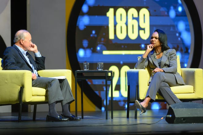 Former Secretary of State Condoleezza Rice talks with Purdue President Mitch Daniels during a conversation Wednesday, Oct. 9, 2019, at a packed Elliott Hall of Music at Purdue University.