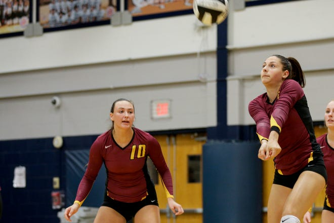 McCutcheon's Chloe Chicoine (5) hits the ball as McCutcheon's Brooke Humphrey (10) watches on during the first set of an IHSAA girls volleyball match, Wednesday, Oct. 9, 2019 in Lafayette. McCutcheon won, 3-0(25-19, 25-16, 25-12).