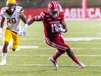 UL wide receiver Jarrod Jackson runs the ball as the Louisiana Ragin' Cajuns take on the Appalachian State Mountaineers at Cajun Field Wednesday, Oct. 9, 2019.