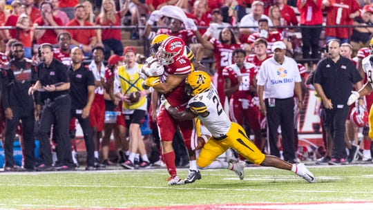 UL running back Elijah Mitchell is brought down in Appalachian State's 17-7 win over the Ragin' Cajuns on Wednesday night at Cajun Field.