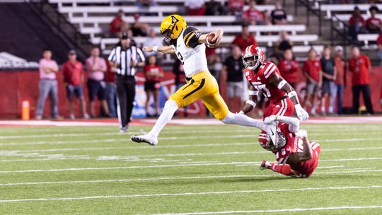UL defenders try to stop the Mountaineers' run as the Louisiana Ragin Cajuns take on App State at Cajun Field.  Wednesday, Oct. 9, 2019.