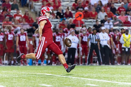Rhys Byrns punts for UL against Appalachian State last Wednesday night at Cajun Field.