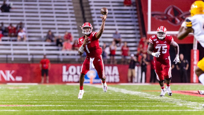 Quarterback Levi Lewis throws a pass as The Louisiana Ragin Cajuns take on App State at Cajun Field.  Wednesday, Oct. 9, 2019.