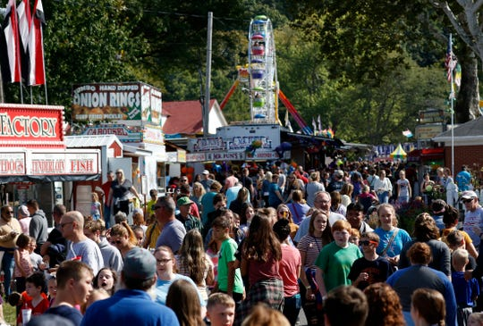 People crowd the midway Thursday, Oct. 10, 2019, at the Fairfield County Fair in Lancaster.