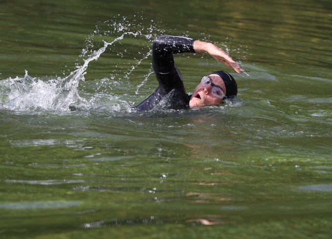 A gentleman, who said he was training for the Ironman Triathlon, swam in the Ohio River near Towhead Island were algae has been forming on Oct. 10, 2019 in Louisville, Ky.