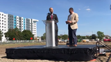 Developer Joel Ferguson, Mayor Andy Schor and former mayor Verg Bernero speak at Red Cedar development groundbreaking in Lansing.