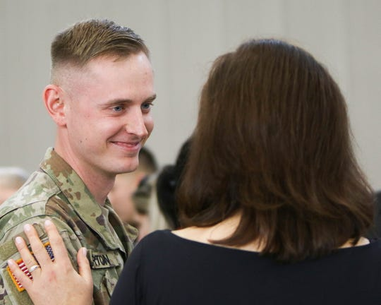 Michigan Governor Gretchen Whitmer personally thanked each of about 80 members of the Michigan Army National Guard, including Andrew Burton, left, of Marquette, during a deployment departure ceremony in Grand Ledge.  The soldiers will head to different parts of the Middle East, potentially conducting air medical evacuation missions as part of combat operations against ISIS and other terrorist organizations.