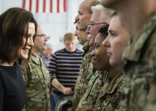 Michigan Governor Gretchen Whitmer personally thanks each of about 80 members of the Michigan Army National Guard, Thursday, Oct. 10, 2019, during a deployment departure ceremony in Grand Ledge.  They will head to different parts of the Middle East, and will potentially be conducting air medical evacuation missions as part of combat operations against ISIS and other terrorist organizations.