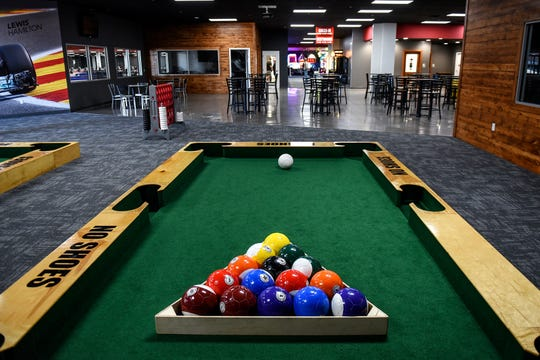 Pocket soccer tables available for patrons at High Caliber Karting and Entertainment on Wednesday, Oct. 9, 2019, inside the Meridian Mall in Okemos. Pocket soccer is played on a large pool table on the ground using soccer balls.