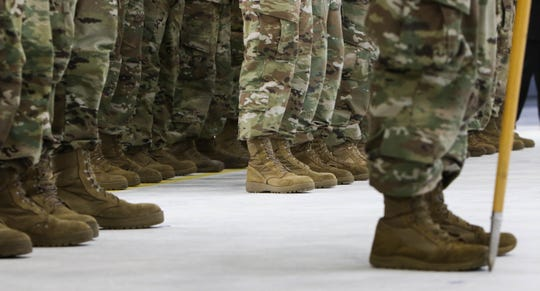 Members of the Michigan Army National Guard stand in formation Thursday, Oct. 10, 2019 during a deployment departure ceremony at the Army Aviation Facility in Grand Ledge. About 80 soldiers will head to different parts of the Middle East, potentially conducting air medical evacuation missions as part of combat operations against ISIS and other terrorist organizations.
