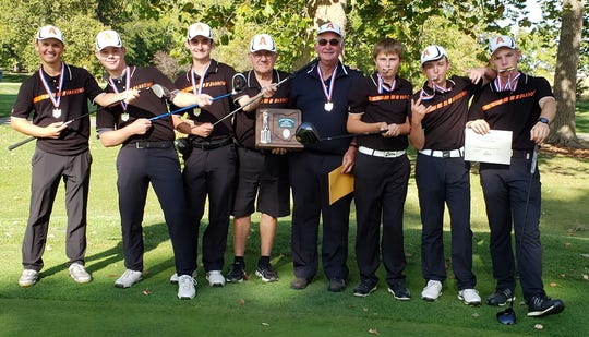 Head coach Dan Priest (fourth from right) and his state-bound Ashland Arrows celebrate their runner-up finish in Thursday's Division I district golf tournament. Sophomore Tyler Sabo (far right) was co-medalist.