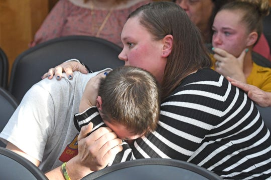 Kyle and Kristi Scott embrace after addressing their son Zamien's killer during Kory Baugh's sentencing Thursday morning.