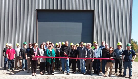 A ribbon cutting at Simcote's new building on North Greenwood Street.