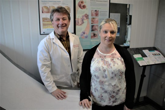 Rachelle Smith, right, of Caledonia, was diagnosed with the mysterious and painful skin disorder known as hidradenitis suppurativa (HS) when she was 13. Two years ago, she began receiving treatments of Humira from Dr. Scott Drew, left, of Dermatology Associates of Mid-Ohio. Smith said the condition has completely cleared up.