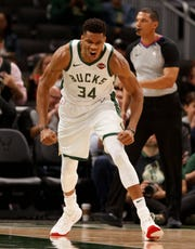 Bucks forward Giannis Antetokounmpo uses the preseason to practice his scowl after throwing home a dunk against the Jazz on Wednesday night.