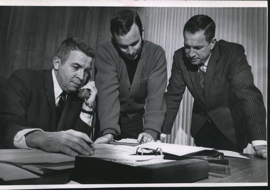 This is the scene as Milwaukee Bucks' officials make their first, two draft picks Monday by telephone. Left to right are (John Erickson,) general manager; Tom Nissalke, assistant coach, and Coach Larry Costello. Their second choice after Lew Alcindor was Rutgers' Bob Greacen. There only two rounds picked.