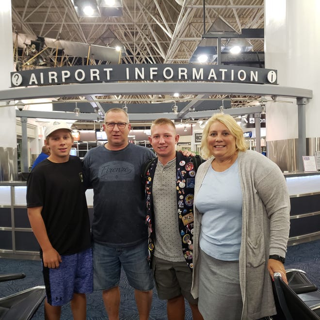 Chris Otto, who has metastatic breast cancer, is shown with her family, husband Fred, and sons William, 17, and Nick, 13.