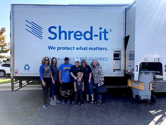 The recent Shred-a-Thon conducted by Arvest Bank raised $829 for Gamma House in Mountain Home. Pictured are: (from left) Sally Gilbert, Arvest; Dawn Cotter, Arvest; David McBee, Arvest; Ashley Hambelton and her son, Max, Arvest; Cheryl Aliosi, Arvest; and Judy Strother, board member, Gamma House.