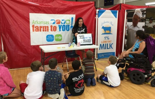 Mountain Home High School student Juana Hernandezteaches fourth-grade students atHackler Intermediate School about dairy products.