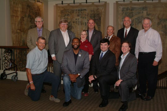Several Troy fans were on hand at the Oct. 8 Montgomery Quarterback Club meeting to greet Troy head football coach Chip Lindsey, the featured speaker.  Standing from left, J. Ray Warren, Jay Mims, Jane Cameron, coach Lindsey, Rich Little, Sam Johnson and Jack Galassini. Kneeling from left, Steve Schwartz, Ernest Claybon, Ben Venable, and Kendall Leverette.