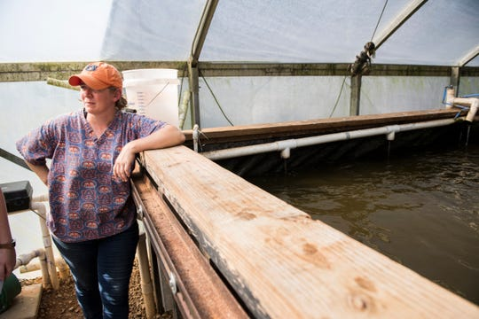 Mollie Smith, school of fisheries, talks about the aquaponics project at Auburn University in Auburn, Ala., on Wednesday, Sept. 11, 2019.