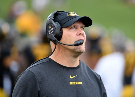 Oct 5, 2019; Columbia, MO, USA; Missouri Tigers head coach Barry Odom watches the replay board during the second half against the Troy Trojans at Memorial Stadium/Faurot Field. Mandatory Credit: Denny Medley-USA TODAY Sports
