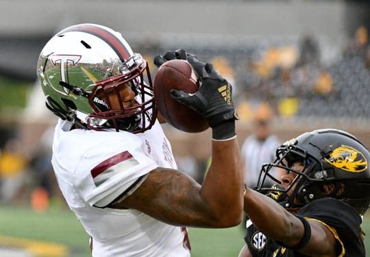 Oct 5, 2019; Columbia, MO, USA; Troy Trojans wide receiver Khalil McClain (6) catches a pass as Missouri Tigers safety Ronnell Perkins (3) defends during the second half at Memorial Stadium/Faurot Field. Mandatory Credit: Denny Medley-USA TODAY Sports