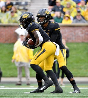 Oct 5, 2019; Columbia, MO, USA; Missouri Tigers quarterback Kelly Bryant (7) hands off to running back Tyler Badie (1) during the first half against the Troy Trojans at Memorial Stadium/Faurot Field. Mandatory Credit: Denny Medley-USA TODAY Sports