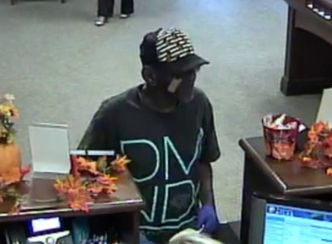 A man entered a bank in the 4200 block of Carmichael Road, produced a note and fled on foot after the robbery.