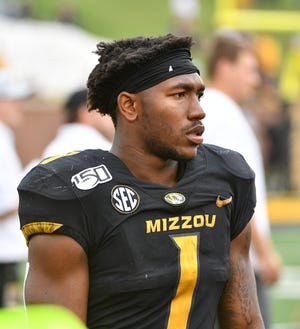 Oct 5, 2019; Columbia, MO, USA; Missouri Tigers running back Tyler Badie (1) watches play during the second half against the Troy Trojans at Memorial Stadium/Faurot Field. Mandatory Credit: Denny Medley-USA TODAY Sports