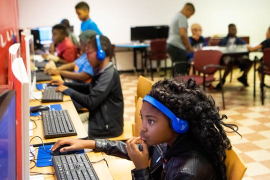Jada Harraway, 9, plays on the computer at the Cleveland Park Boys and Girls Club Wednesday, Oct. 9, 2019, in Nashville, Tenn.
