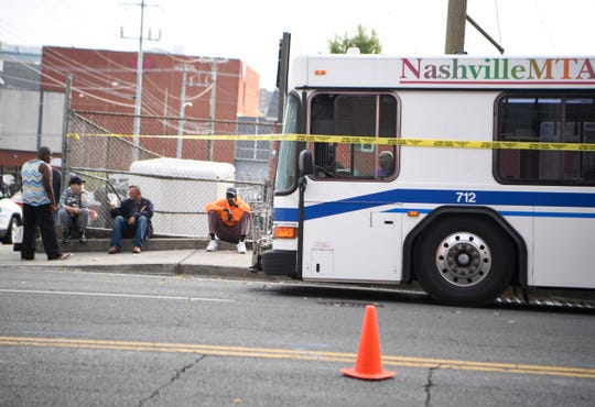 A Nashville public transit bus sits at the scene where a pedestrian was struck and killed in the Gulch near downtown Thursday, Oct. 10, 2019.