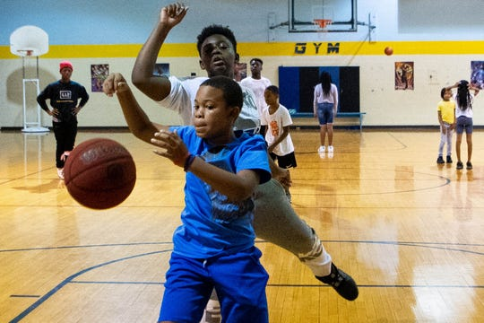 Kenneth Taylor, 10, chases after the rebound while playing at the Cleveland Park Boys and Girls Club Wednesday, Oct. 9, 2019, in Nashville, Tenn.
