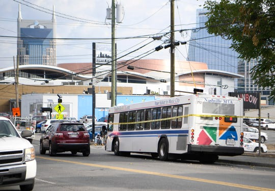 A Nashville public transit bus sits near the spot where a pedestrian was struck and killed in the Gulch near downtown Nashville Thursday, Oct. 10, 2019.