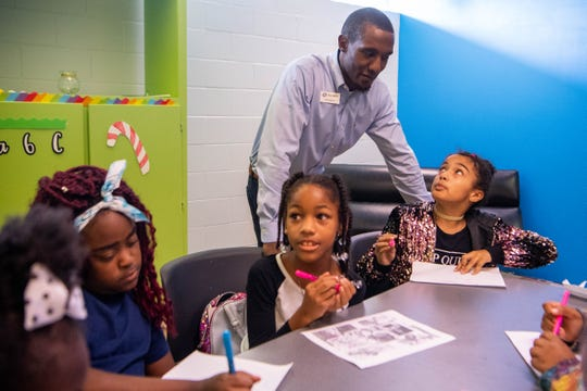 Unit Director Herbert Myers checks in on children at the Cleveland Park Boys and Girls Club Wednesday, Oct. 9, 2019, in Nashville, Tenn.