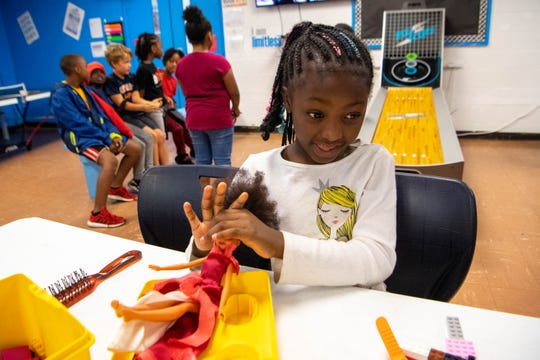 Deidriana Davis, 7, plays with a doll at the Cleveland Park Boys and Girls Club Wednesday, Oct. 9, 2019, in Nashville, Tenn.