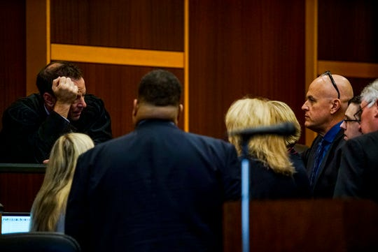 Judge Bruce Kyle talks to the defense and prosecution including Jimmy Rodgers before the trial began for the day. Opening statements from the defense and prosecution in the Jimmy Rodgers trial at the Lee County Justice Center, Fort Myers, FL, October 10, 2019. He is on trial for the murder of Teresa Sievers.