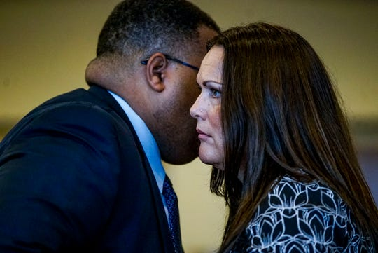 Ann Lisa, Teresa Sievers' sister, talks to the Assistant State Attorney Hamid Hunter Thursday' in advance of the opening statements from the defense and prosecution for the Jimmy Rodgers trial at the Lee County Justice Center. Rodgers  is on trial for the murder of Teresa Sievers.