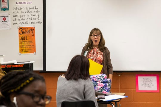 Annette Hall is surprised by the presentation of a grant from Champions For Learning on Thursday, Oct. 10, 2019, at Lely High School in East Naples.