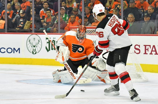 Oct 9, 2019; Philadelphia, PA, USA; Philadelphia Flyers goaltender Carter Hart (79) makes a save as New Jersey Devils center Jack Hughes (86) looks for rebound during the first period at Wells Fargo Center.
