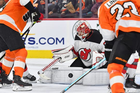Oct 9, 2019; Philadelphia, PA, USA; New Jersey Devils goaltender Cory Schneider (35) makes a save against the Philadelphia Flyers during the second period at Wells Fargo Center.
