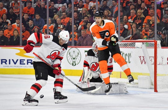 Oct 9, 2019; Philadelphia, PA, USA; New Jersey Devils defenseman Andy Greene (6) blocks shot as Philadelphia Flyers left wing James van Riemsdyk (25) screens New Jersey Devils goaltender Cory Schneider (35) during the second period at Wells Fargo Center.