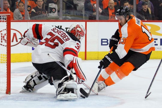 New Jersey Devils' Cory Schneider blocks the shot of Philadelphia Flyers' Kevin Hayes during the second period of an NHL hockey game Wednesday, Oct. 9, 2019, in Philadelphia.