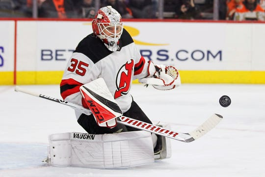 New Jersey Devils' Cory Schneider deflects a shot during the second period of the team's NHL hockey game against the Philadelphia Flyers on Wednesday, Oct. 9, 2019, in Philadelphia.